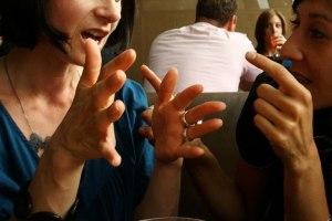 P9 two women hand_gestures