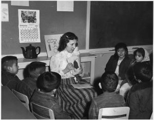 white teacher with navajo students